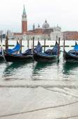 Venetian gondolas with high tide. — Stock Photo