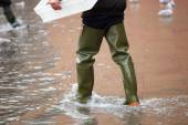 Close Up of legs with boots due to the high water in Venice. — Stock Photo