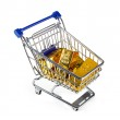 Gold bullion in shopping cart — Stock Photo #65109595