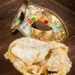 Fried pastry of italian carnival with venetian mask. — Stock Photo #65179551