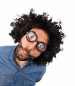 Funny young man with unkempt hair and thick glasses. — Stock Photo