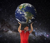 Man to lift Earth planet above head. — Stock Photo