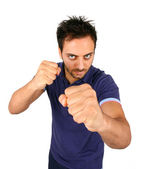 Young Aggressive Man Show His Fists — Stock Photo