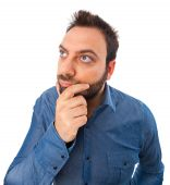 Funny young man looks for an idea — Stock Photo