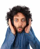 Young surprised man with headphones — Stock Photo