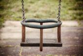 Empty swing on the playground — Stock Photo