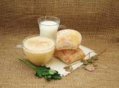 Milk, fermented baked milk with foam, bread, parsley and dried c — Stock Photo