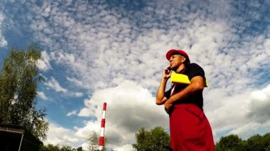 Industrial Worker and Red Factory Chimney Zoom In — Stock Video