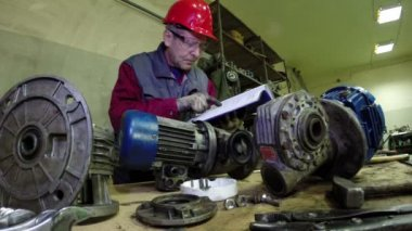 Maintenance Engineer Checking Technical Data — Stock Video