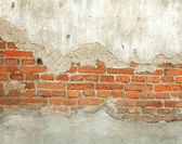 Old weathered red brick wall. — Photo