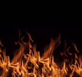 Flames on a black background. — Stock Photo