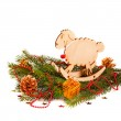 Christmas composition with fir branches, wooden toy a sheep, Christmas decorations — Stock Photo #59409825