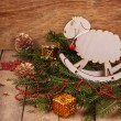 Christmas composition with fir branches, wooden toy a sheep, Christmas decorations — Stock Photo #59409831