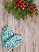 Handmade mittens, fir branches and christmas decoration — Stock Photo