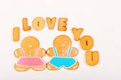 """Gingerbread men and the words """"I love you"""". — Stock Photo"""