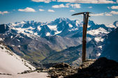 Ice ax and views of the valley — Stock Photo