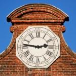 White clock on a brick wall — Stock Photo #73802637
