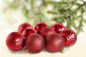 Red Christmas balls on the table with a Christmas tree — Stock Photo