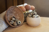 Chicken and quail eggs, healthy food with chicken farm on the table — Stock Photo