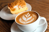Cappuccino cup with cake — Stock Photo