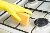 Cleaning of dirty gas stove burner — Stock Photo