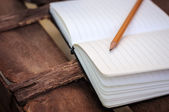 Notepad with pen on wood table — Stock Photo