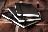 Notepads on brown wood table — Stock Photo
