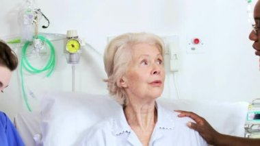 Health care staff at bedside of patient — Stock Video