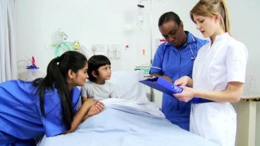 Specialist Nursing Staff Treating Child Patient — Stock Video