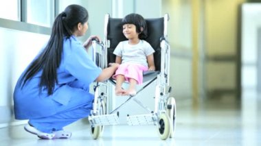 Little Asian Indian Girl Wheelchair Hospital Corridor — Stock Video