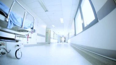 Multi Ethnic Staff Moving Patients Hospital Corridor — Wideo stockowe