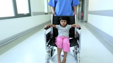 Little Girl Wheelchair Pushed Busy Hospital Corridor — Stock Video