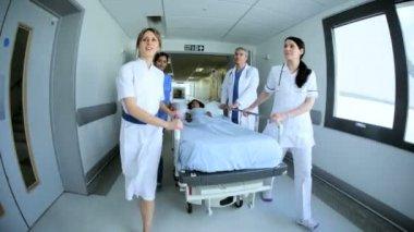 Multi Ethnic Nursing Staff Pushing Patient Bed Hospital — Stok video