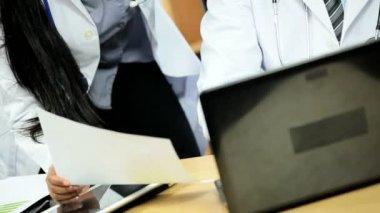 Doctors using patient computer information — Stock Video