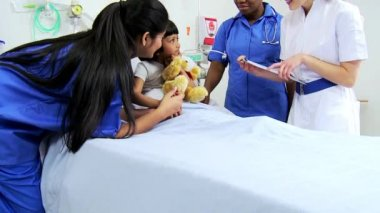 Multi Ethnic Nursing Staff Recording Child Patient Treatment — Stock Video