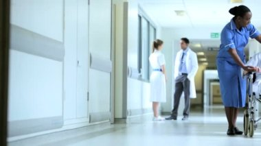 Multi Ethnic Staff Moving Patients Hospital Corridor — Vídeo Stock
