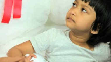 Child patient receiving dedicated nursing care — Video Stock