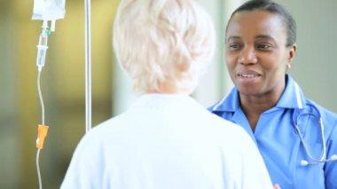 Older Patient Ethnic Nurse Hospital Corridor — Stock Video