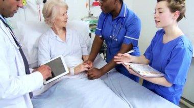 Senior Caucasian Hospital Patient Multi Ethnic Medical Staff — Stock Video