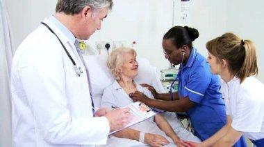 Elderly Female Caucasian Hospital Bed Nursing Care — Stock Video