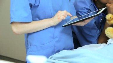 Nursing staff using wireless tablet  information — Stock Video