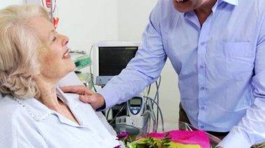 Son Visiting Elderly Mom Hospital Bringing Flowers — Stock Video