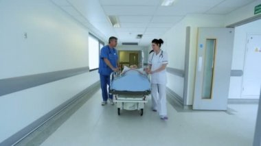 Medical Staff Transferring Patient Hospital Bed — Vídeo de stock