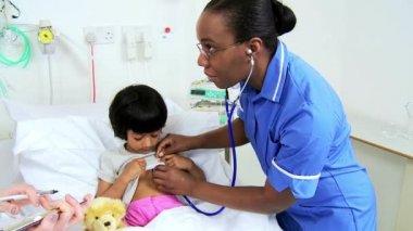 Specialist Nursing Staff Treating Child Patient — Stock Video