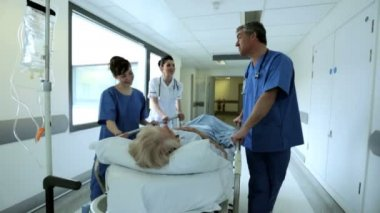 Patient Hospital Bed Moved by Medical Staff Slow Motion — Vídeo Stock