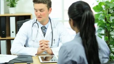 Pharmaceutical saleswoman meeting doctor in office — Wideo stockowe