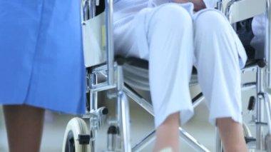 Close Up Hospital Corridor Ethnic Nurse Wheelchair Patient — Stock Video