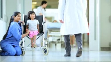 Busy Multi Ethnic Hospital Staff Caring Child Patients — Stock Video