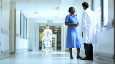 Wheelchair Patient Corridor Busy Hospital — Stock Video