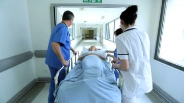 Medical Staff Transferring Patient Hospital Bed Slow Motion — Stock Video